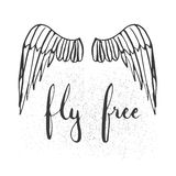 Hand drawn typography lettering phrase Fly free with birds wings on the white background. Stock Photo