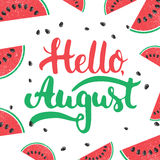 Hand drawn typography lettering phrase Hello, august on the watermelon background.  Royalty Free Stock Images