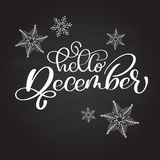 Hand drawn typography lettering phrase Hello December on a chalkboard with snowflakes. Fun brush ink calligraphy Royalty Free Stock Image