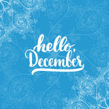 Hand drawn typography lettering phrase Hello, December isolated on the blue doodle background. Fun brush ink calligraphy Stock Photography