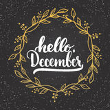 Hand drawn typography lettering phrase Hello, December isolated on the chalkboard background with golden wreath. Hand drawn typography lettering phrase Hello Royalty Free Stock Photography