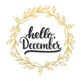 Hand drawn typography lettering phrase Hello, December isolated on the white background with golden wreath. Fun brush. Hand drawn typography lettering phrase Stock Photography