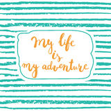 Hand drawn typography lettering phrase My life is my adventure isolated on the green striped background. Stock Photo