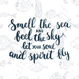 Hand drawn typography lettering phrase Smell the sea and feel the sky let your soul and spirit fly Stock Photos