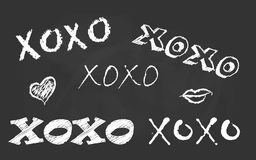 Hand drawn typography lettering Xoxo Royalty Free Stock Image