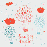 Hand drawn typography poster. Love is in the air Stock Photography
