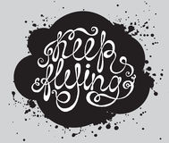 Hand drawn typography poster. Phrase Keep flying with black clou Stock Photos