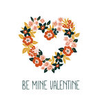 Hand drawn valentine card with floral heart and lettering - `Be mine Valentine`. Vector floral frame design. Royalty Free Stock Images