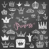Hand drawn Various crowns set, vector illustration doodle cute s. Tyle on the chalk board. Black and white Royalty Free Stock Photo