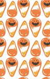 Hand drawn vector abstract cartoon Happy Halloween illustration seamless pattern with orange candy cones isolated on Royalty Free Stock Images