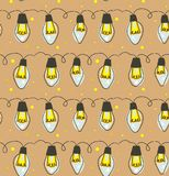 Hand drawn vector abstract fun Merry Christmas time cartoon rustic festive seamless pattern with cute illustrations of. Lights bulb garland  on craft paper Royalty Free Stock Image