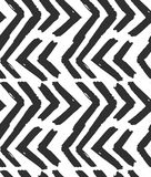 Hand drawn vector abstract rough geometric monochrome seamless zig zag chevron pattern in black and white colors.Hand Stock Image