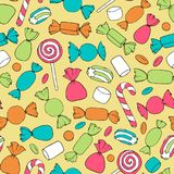 Hand drawn vector candies, canes and marshmallows seamless pattern on the yellow background. Holiday decoration in bright colors Stock Images
