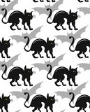 Hand drawn vector cartoon seamless pattern with black cat and shape of bat shadow isolated on white.Halloween holiday Stock Images