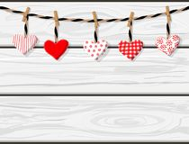 Hand drawn vector cartoon white wooden planks boards texture with handmade textile hearts hanging. St.Valentine`s concept stock illustration