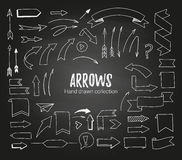 Hand drawn vector illustration - arrows, ribbons and scrolls. Sk Stock Photo