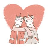 A couple of unicorns wrapped in one scarf. Hand drawn vector illustration of a couple of cute funny unicorns in coats, holding hands and wrapped in a scarf, with Stock Image