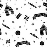 Hand drawn vector illustration of circus items seamless pattern on a white background. Hand drawn vector illustration of crazy creepy cartoon circus items: wind stock illustration