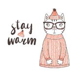 Cute funny cat in a knitted hat and sweater. Hand drawn vector illustration of a cute funny cat in a knitted hat with pompom and sweater, text Stay warm Royalty Free Stock Image