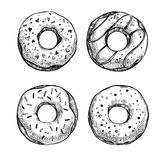 Hand drawn vector illustration - Set of tasty donuts. Sketch. Sw Royalty Free Stock Photos