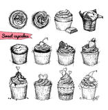 Hand-drawn vector illustration - Sweet cupcakes. Line art. Isola Stock Photos