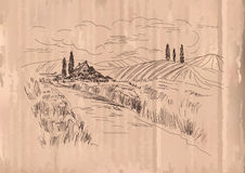 Hand drawn vector Illustration of wheat fields and village house. Ink drawing in vintage style on cardboard background.  Royalty Free Stock Photo