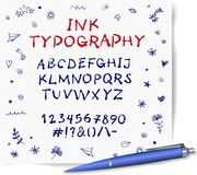 Hand-drawn vector ink pen sketch font on lined paper background with doodles. Royalty Free Stock Photography