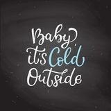 Hand drawn vector lettering Baby It is Cold Outside.  ca Stock Photo