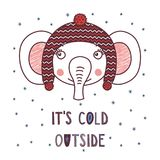 Cute elephant in a warm hat. Hand drawn vector portrait of a cute funny elephant in a warm hat with pompoms, text It`s cold outside. Isolated objects on white Royalty Free Stock Images