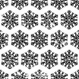 Hand drawn vector seamless pattern with black snowflakes isolate Stock Photography