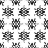 Hand drawn vector seamless pattern with black snowflakes isolate Royalty Free Stock Photo