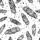 Hand drawn vector seamless pattern with painted bird feathers. T. Itled background. Black and white art for your design. Trendy boho style patterned elements Stock Photography