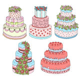 Hand drawn vector set with cute triple birthday cakes. Doodle cakes with cream and berries. Royalty Free Stock Image