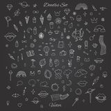 Hand drawn vector set of random doodles with rainbows, lips, pla. Nets, skulls, plants and more. Chalk Stock Photography