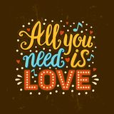 Hand drawn vector vintage lettering All you need is love. Distressed texture illustration with words, hearts and music notes Royalty Free Stock Photography