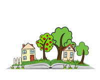 Hand drawn village scene with trees, houses and grass on an open book Royalty Free Stock Photography