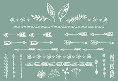 Hand drawn vintage arrows, feathers, dividers and floral elements. Vector illustration Stock Photos