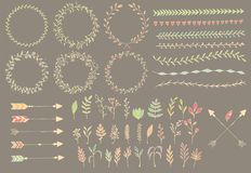 Hand drawn vintage arrows, feathers, dividers and floral elements. Vector illustration vector illustration