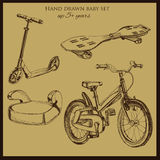 Hand drawn vintage baby transport. Vector illustration of hand drawn vintage baby transport include  booster car, scooter, bicycle and wave board Stock Photos