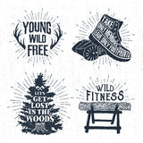 Hand drawn vintage badges set with textured horns, boots, fir tree, and log illustrations. Royalty Free Stock Photos