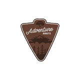 Hand drawn vintage camping badge and hiking label with mountains, forest, climb helmet and typography design elements. Quote text- Adventure awaits. Old style Royalty Free Stock Photography