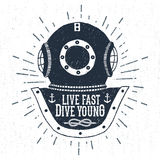 Hand drawn vintage diving helmet vector illustration. With `Live fast dive young` lettering Royalty Free Stock Photo