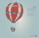 Hand drawn vintage hot air balloon with inspirational message Stock Photos