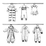 Hand drawn wardrobe sketch. Baby clothes. Doodles stock images