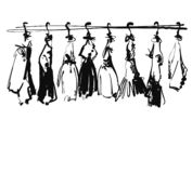 Hand drawn wardrobe sketch. Baby clothes on hungers. Dress stock photography
