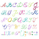 Hand drawn watercolor alphabet. Handwritten multicolor font isolated on white background. Contains uppercase letters, numbers, punctuation signs and most Stock Photography