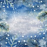 Hand drawn watercolor blue winter background. Hand drawn watercolor floral frame with tree branches and snow on blue paper background Stock Photos