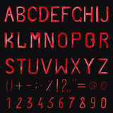 Hand drawn watercolor font on black background. Numbers and symb Stock Images