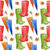Hand drawn watercolor seamless pattern with autumn elements. Umbrella, leaf, rubber boots. Royalty Free Stock Photography