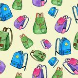 Hand-drawn watercolor seamless pattern with colored backpacks stock illustration